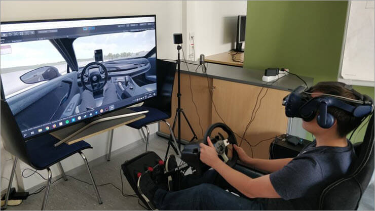 Virtual reality head mounted display steering wheel.